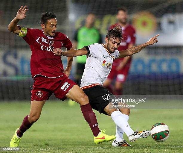 David Di Michele of Reggina competes for the ball with Saro Bucolo of Messina during the Lega Pro match between Reggina Calcio and ACR Messina at...