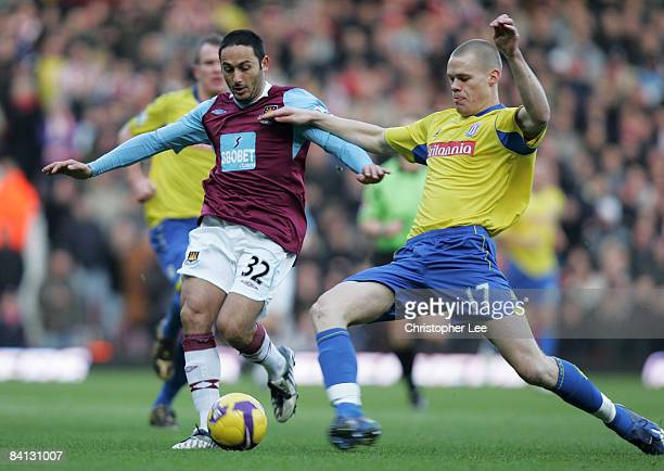 David Di Michele of West Ham is tackled by Ryan Shawcross of Stoke during the Barclays Premier League match between West Ham United and Stoke City at...