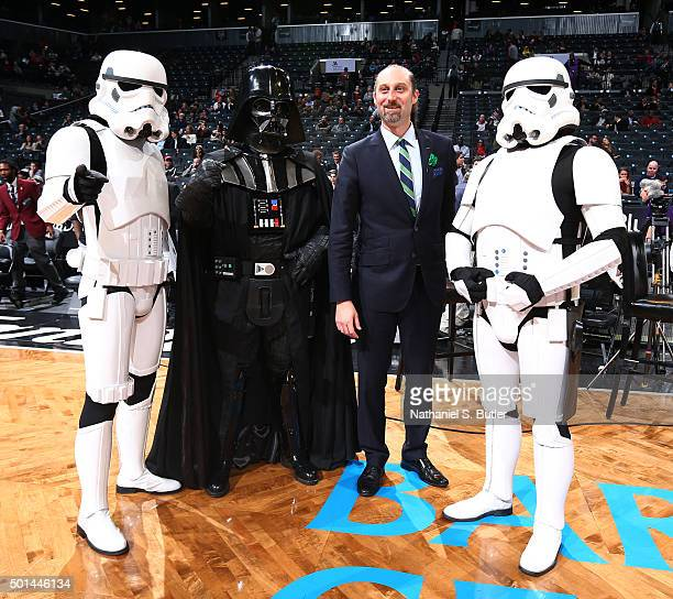 David Diamante poses for a photo with Star Wars characters during a game between the Orlando Magic and the Brooklyn Nets on December 14 2015 at...