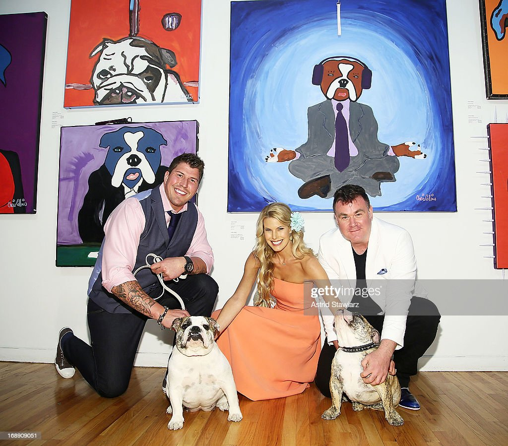 David Diehl, Beth Ostrosky Stern and artist Chris Collins pose for photos during the Chris Collins 'Top Dogs' VIP Reception on May 16, 2013 in New York, United States.