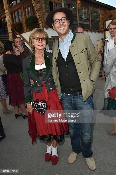 David Dietl and his mother Marianne Dennler attend the Almauftrieb during the Oktoberfest 2015 at Kaefer Tent on September 20 2015 in Munich Germany