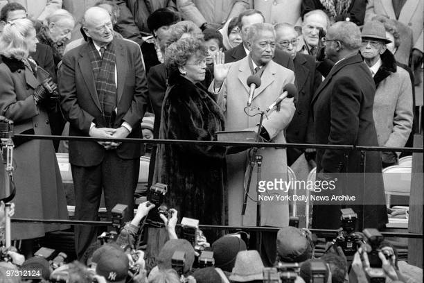 David Dinkins is sworn in as New York's 106th mayor by Court of Appeals Judge Fritz Alexander at City Hall Dinkin's wife Joyce holds bible and former...