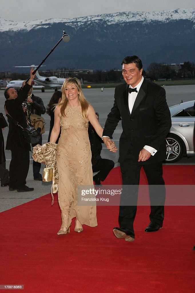 David Douillet (Laureus Academy) and wife Valerie at The 'Iwc Grande Soiree Aviateur' On of the SIHH in Geneva International Airport.