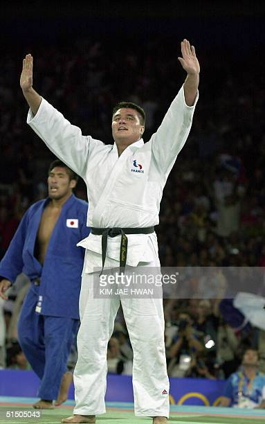 David Douillet of France celebrates his gold medal victory in the Olympic men's heavyweight over 100kg final against Shinichi Shinohara of Japan 22...