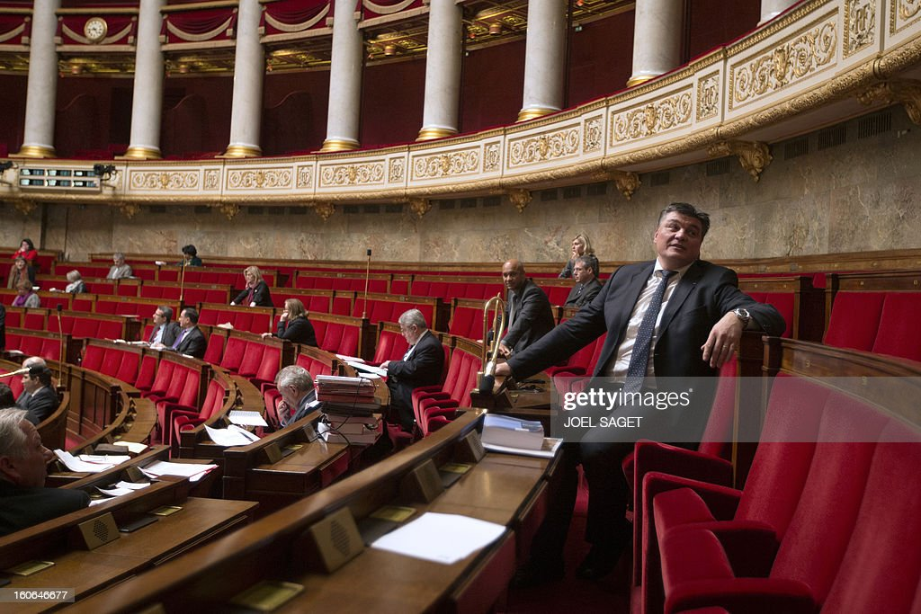 David Douillet takes part in the debate to allow gay couples to get married and adopt children on February 4, 2013 at the National Assembly in Paris. Two days before, Members of Parliament voted 249-97 in favour of Article One of the draft law, which redefines marriage as being a contract between two people rather than necessarily between a man and a woman. AFP PHOTO JOEL SAGET