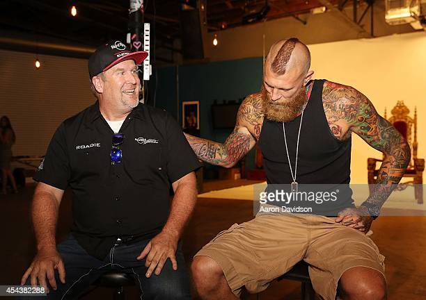 David Drow and Chris Andersen promotes Hard Rock Energy Drink on August 29 2014 in Fort Lauderdale Florida