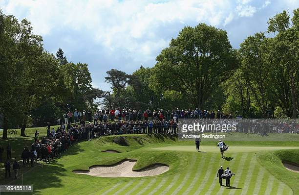 David Drysdale of Scotland and Graeme Storm of England walk on to the second green during the third round of the BMW PGA Championship on the West...