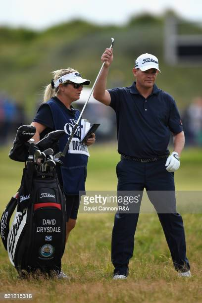 David Drysdale of Scotland and his caddie and wife Vicky Drysdale on the 18th hole during the final round of the 146th Open Championship at Royal...