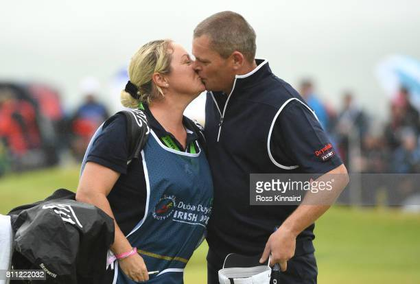 David Drysdale of Scotland completes his round on the 18th green with wife / caddie Vicky during the final round of the Dubai Duty Free Irish Open at...