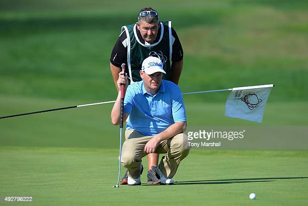David Drysdale of Scotland lines up his putt on the 9th green during the first round of the Portugal Masters at Oceanico Victoria Golf Club on...