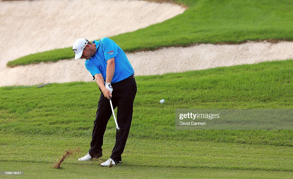 David Drysdale of Scotland plays his approach to the par 5, 18th hole during the first round of the 2012 DP World Tour Championship on the Earth Course at Jumeirah Golf Estates on November 22, 2012 in Dubai, United Arab Emirates.