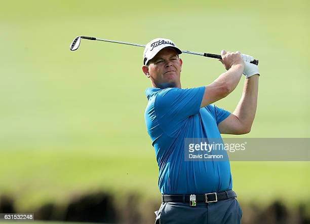 David Drysdale of Scotland plays his second shot on the 12th hole during the first round of the 2017 BMW South African Open Championship at Glendower...