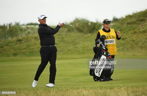 David Drysdale of Scotland plays his second shot on the 9th hole with wife and caddie Vicky during the second round of the 146th Open Championship at...