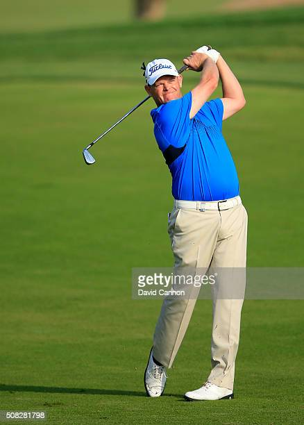 David Drysdale of Scotland plays his second shot on the par 5 10th hole during the first round of the 2016 Omega Dubai Desert Classic on the Majlis...