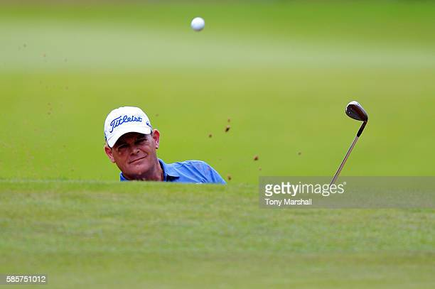 David Drysdale of Scotland plays out of a bunker onto the green at hole 2 on day one of the Aberdeen Asset Management Paul Lawrie Matchplay at...
