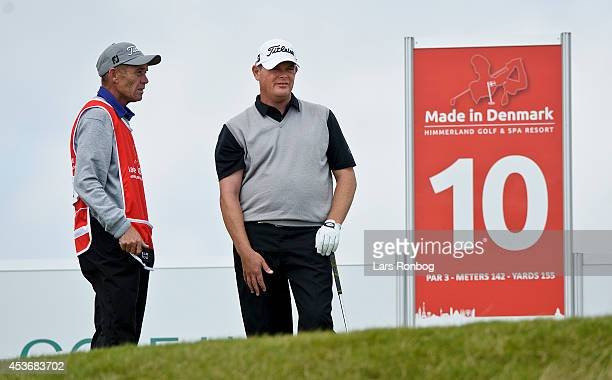 David Drysdale of Scotland speaks to his caddie at the 10th hole during the third round of the Made In Denmark at Himmerland Golf Spa Resort on...