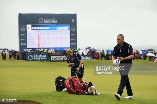 David Drysdale of Scotland walks off the 18th green with wife / caddie Vicky during the final round of the Dubai Duty Free Irish Open at Portstewart...