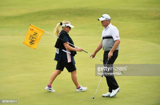 David Drysdale of Scotland walks on the 5th green with wife / caddie Vicky during the third round of the 146th Open Championship at Royal Birkdale on...