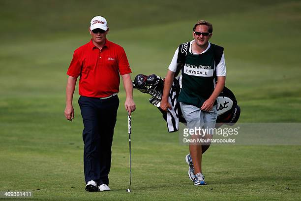 David Drysdale of Scotland walks towards the 11th green with his caddie during Day 2 of the Africa Open at East London Golf Club on February 14 2014...