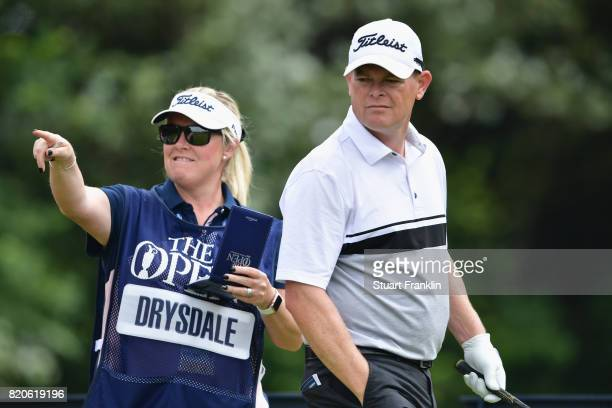 David Drysdale of Scotland with his caddie and wife Vicky Drysdale on the 5th tee during the third round of the 146th Open Championship at Royal...
