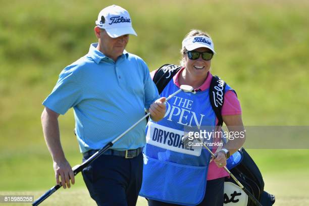 David Drysdale of Scotland with his wife and caddie Vicky Drysdale during a practice round prior to the 146th Open Championship at Royal Birkdale on...