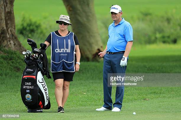 David Drysdale of Scotland with his wife Victoria caddying during the third round of the Alfred Dunhill Championships at Leopard Creek Country Golf...