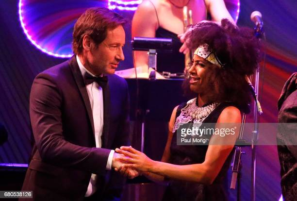 David Duchovny and Esperanza Spaulding onstage at the show finale at the 2017 Kennedy Center Spring Gala Come Together A Celebration of John Lennon...