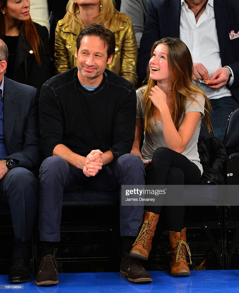 <a gi-track='captionPersonalityLinkClicked' href=/galleries/search?phrase=David+Duchovny&family=editorial&specificpeople=201628 ng-click='$event.stopPropagation()'>David Duchovny</a> and <a gi-track='captionPersonalityLinkClicked' href=/galleries/search?phrase=Madelaine+Duchovny&family=editorial&specificpeople=5632583 ng-click='$event.stopPropagation()'>Madelaine Duchovny</a> attend the Boston Celtics vs New York Knicks game at Madison Square Garden on January 7, 2013 in New York City.