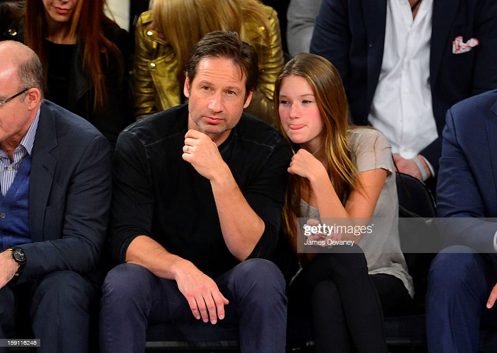 David Duchovny and Madelaine Duchovny attend the Boston Celtics vs New York Knicks game at Madison Square Garden on January 7, 2013 in New York City.