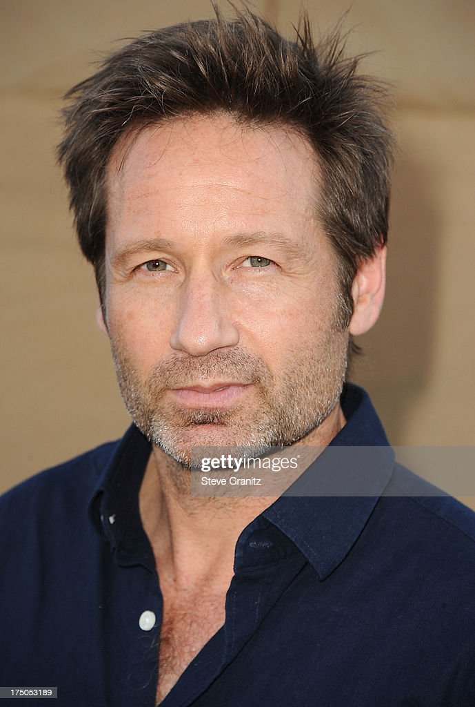 <a gi-track='captionPersonalityLinkClicked' href=/galleries/search?phrase=David+Duchovny&family=editorial&specificpeople=201628 ng-click='$event.stopPropagation()'>David Duchovny</a> arrives at the Television Critic Association's Summer Press Tour - CBS/CW/Showtime Party at 9900 Wilshire Blvd on July 29, 2013 in Beverly Hills, California.