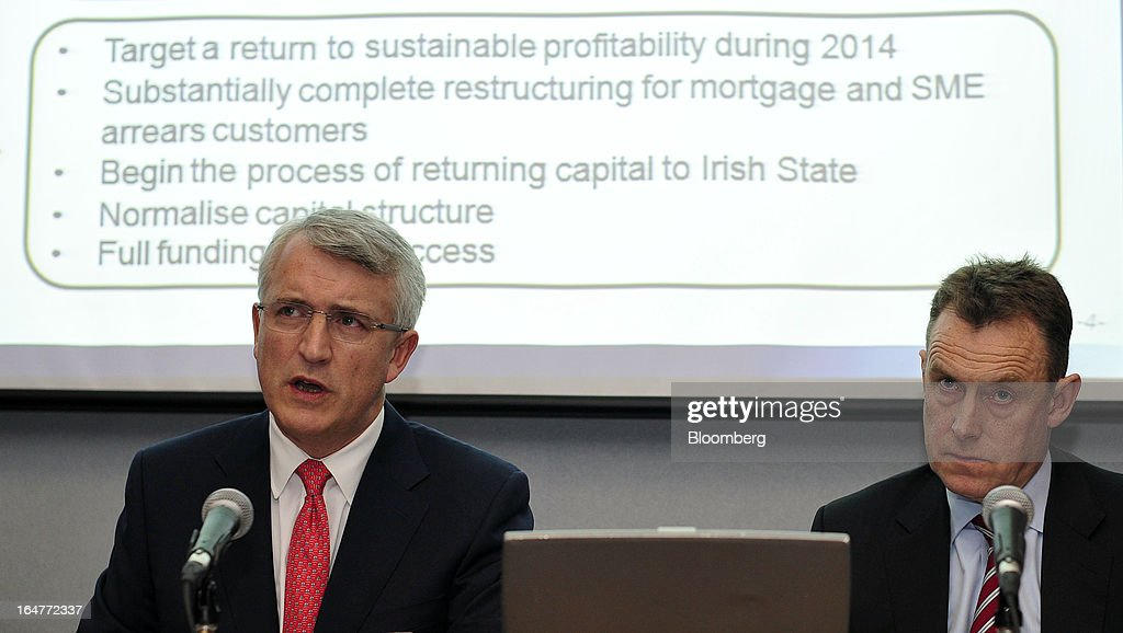 David Duffy, chief executive officer of Allied Irish Banks Plc (AIB), left, speaks as Paul Stanley, chief financial officer of Allied Irish Banks Plc (AIB), listens during a news conference to announce the company's results in Dublin, Ireland, on Wednesday, March 27, 2013. Allied Irish Banks Plc, which cost taxpayers about 21 billion euros ($27 billion) to rescue, said its annual loss widened as a decline in bad loan losses failed to offset dwindling gains from buying back its own debt. Photographer: Aidan Crawley/Bloomberg via Getty Images