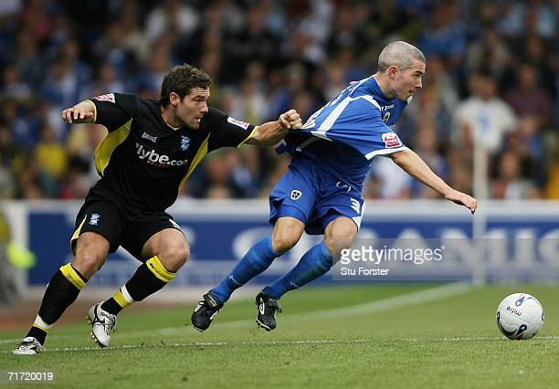 David Dunn of Birmingham is beaten to the ball by Kevin Mcnaughton of Cardiff during the Coca Cola Championship game between Cardiff City and...