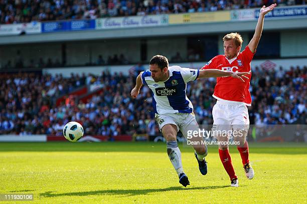 David Dunn of Blackburn holds back Sebastian Larsson of Birmingham City during the Barclays Premier League match between Blackburn Rovers and...