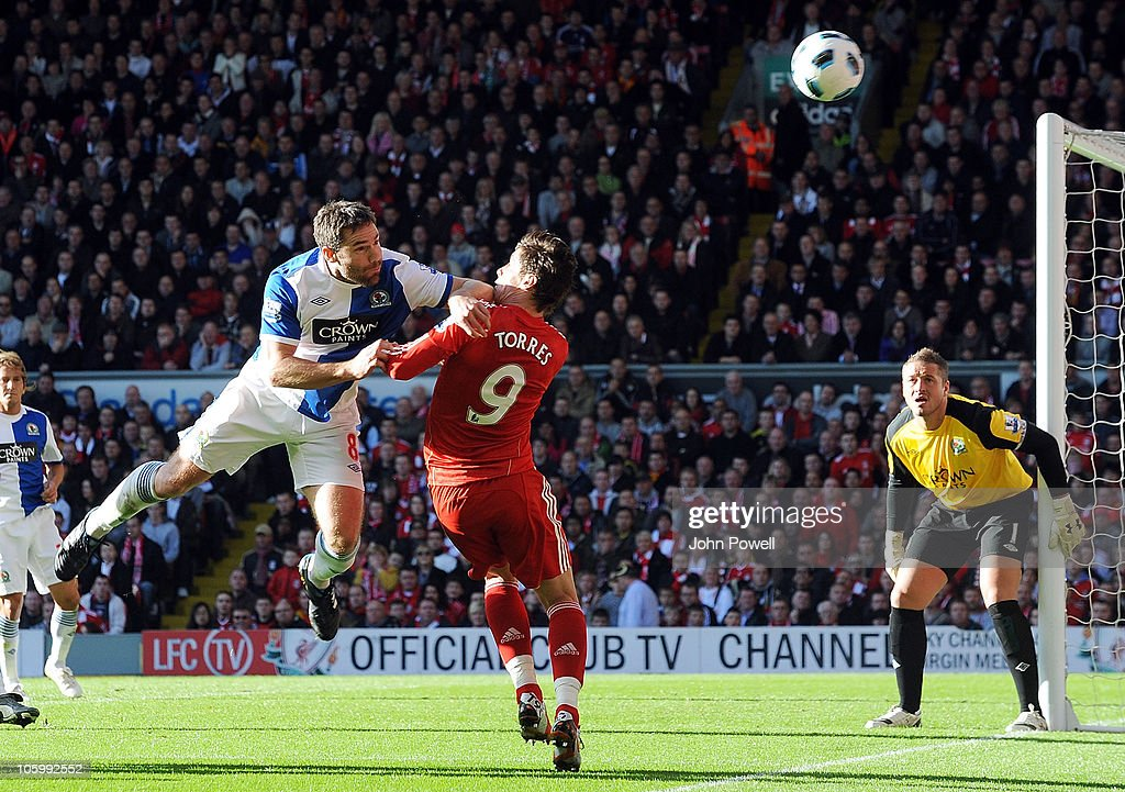 <a gi-track='captionPersonalityLinkClicked' href=/galleries/search?phrase=David+Dunn&family=editorial&specificpeople=217304 ng-click='$event.stopPropagation()'>David Dunn</a> of Blackburn Rovers catches <a gi-track='captionPersonalityLinkClicked' href=/galleries/search?phrase=Fernando+Torres&family=editorial&specificpeople=194755 ng-click='$event.stopPropagation()'>Fernando Torres</a> of Liverpool during the Barclays premier league match between Liverpool and Blackburn Rovers at Anfield on October 24, 2010 in Liverpool, England.