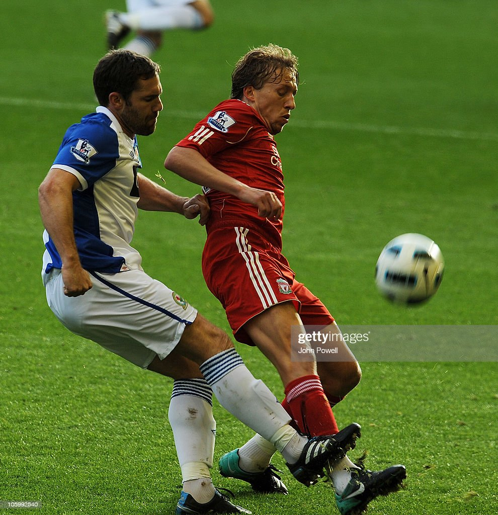 <a gi-track='captionPersonalityLinkClicked' href=/galleries/search?phrase=David+Dunn&family=editorial&specificpeople=217304 ng-click='$event.stopPropagation()'>David Dunn</a> of Blackburn Rovers tussles with Lucas of Liverpool during the Barclays premier league match between Liverpool and Blackburn Rovers at Anfield on October 24, 2010 in Liverpool, England.