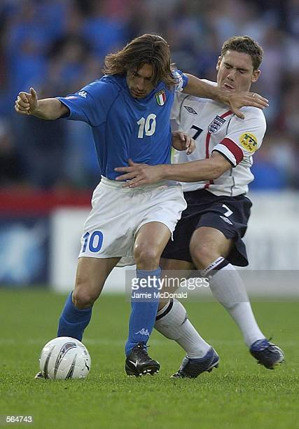 David Dunn of England tussles with Andrea Pirlo of Italy during the European Under 21's Championship Group A game between England and Italy at the St...
