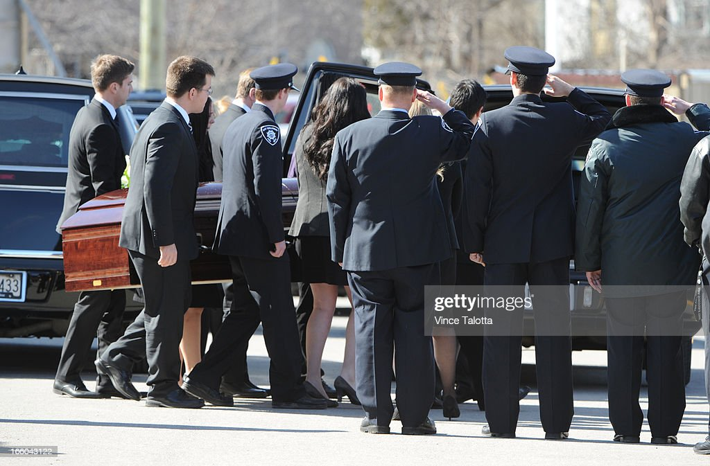 David Dunsmuir (at the end with thin glasses) carries the coffin of his brother ,Cameron Dunsmuir ,16, at the funeral of his family , the Dunsmuir family, killed in the fatal fire in East Gwillimbury a week ago. Kevin Dunsmuir, 55, his wife Jennifer, 51, and his other brother Robert, 19, at St Elizabeth Seton Parish.