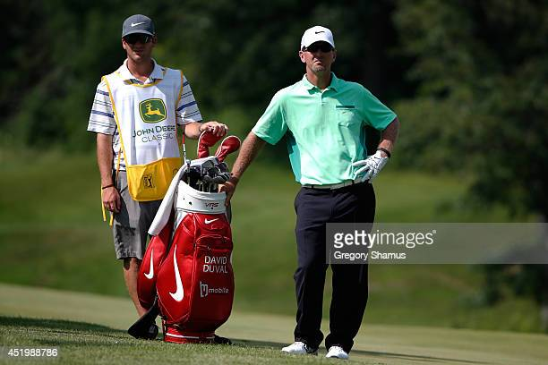 David Duval and his caddie discuss his approach to the 15th green during the first round of the John Deere Classic held at TPC Deere Run on July 10...