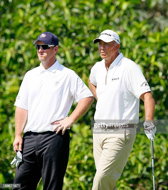 David Duval and Tom Lehman both of the United States wait to tee off the 10th hole during the first round of the Mayakoba Golf Classic at Riviera...