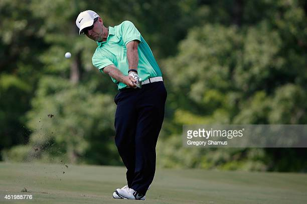 David Duval hits his approach to the 15th green during the first round of the John Deere Classic held at TPC Deere Run on July 10 2014 in Silvis...