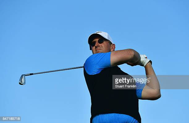 David Duval of the United States hits a shot on the 4th during the first round on day one of the 145th Open Championship at Royal Troon on July 14...