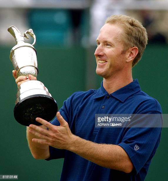 David Duval of the US lifts the Claret Jug after winning the 2001 Open Golf Championship at the Royal Lytham and St Annes golf club 22 July 2001...