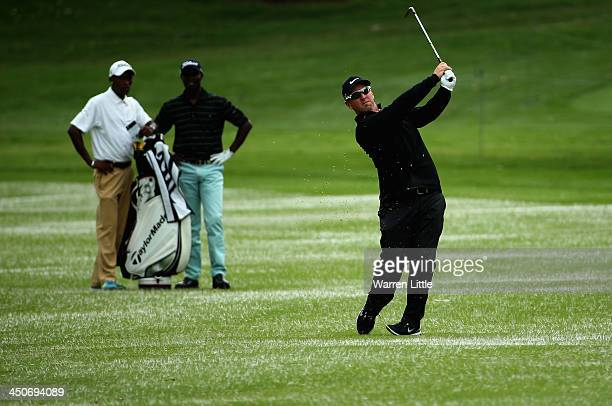 David Duval of the USA is watched by a local professional during a practice round ahead of the South African Open Championship at Glendower Golf Club...