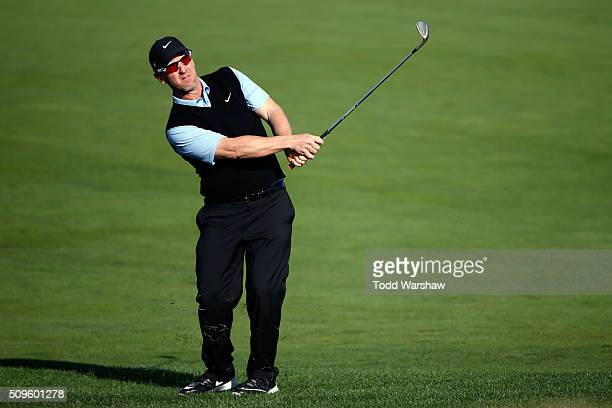 David Duval plays his approach shot on the 10th hole during the first round of the ATT Pebble Beach National ProAm at the Monterey Peninsula Country...