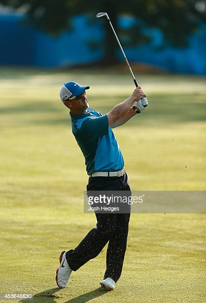 David Duval plays his second shot from the fairway on the first hole during the second round of the Wyndham Championship at Sedgefield Country Club...