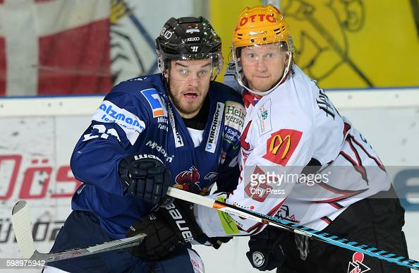 David Dziurzynski of the Iserlohn Roosters and Mike Moore of the Fischtown Pinguins during the test match between the Fischtown Pinguins and the...