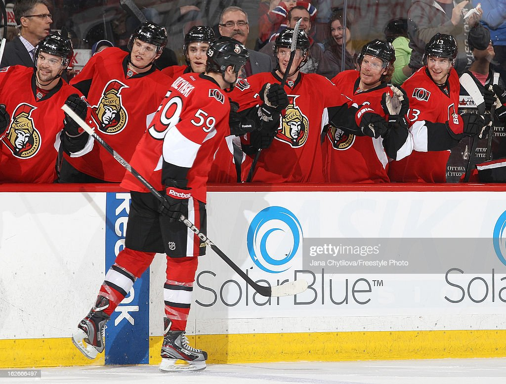 David Dziurzynski #59 of the Ottawa Senators celebrates his second period goal with team mates Colin Greening #14, Kyle Turris #7, Erik Condra #22, Daniel Alfredsson #11 and Peter Regin #13, during an NHL game against the Montreal Canadiens, at Scotiabank Place on February 25, 2013 in Ottawa, Ontario, Canada.