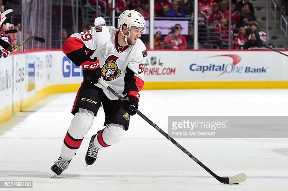 David Dziurzynski of the Ottawa Senators controls the puck in the second period against the Washington Capitals during an NHL game at Verizon Center...