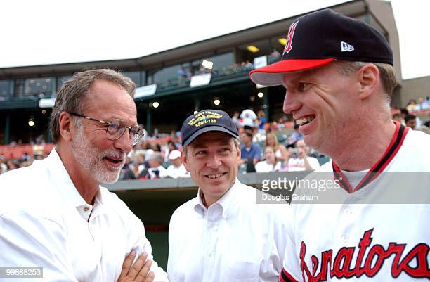 David E Bonior and Tim Holden talk before the start of the 2003 congressional baseball game