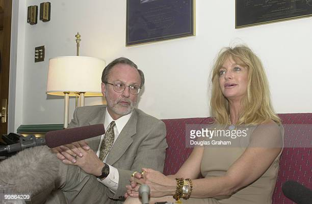 David E Bonior DMi and Goldie Hawn talk with reporters during a press conference in Boniors office about China PNTR